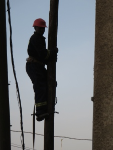 Changing the wires from the old  pole to the new one.